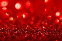 Röd bakgrund med mousserar Arkivfoto