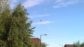 Röd ballong royaltyfri fotografi