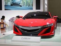 Röd bil för acuransxbegrepp royaltyfri foto