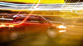 Röd bil i rörelse Royaltyfri Foto