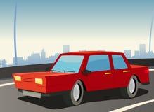Röd bil på stadshuvudvägen Arkivfoton