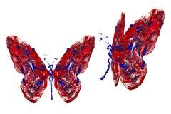 Röd blå vit målarfärg som göras fjärilen att ställa in Arkivbild
