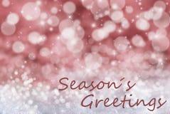 Röd Bokeh julbakgrund, snö, text kryddar hälsningar Arkivbild