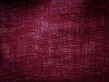 Röd bomullsbakgrund Arkivfoto