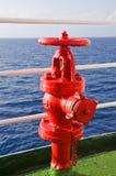 Röd brandpost ombord ett skepp Arkivbild