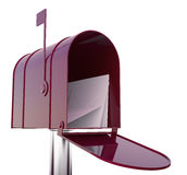 Röd brevlåda med poster Royaltyfri Bild