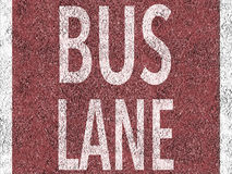 Röd bussfil på asfalt Royaltyfria Bilder