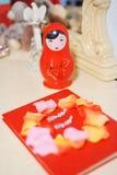 Röd bygga bo docka Royaltyfri Foto
