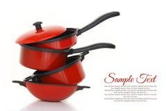 Röd cookwareuppsättning Royaltyfria Foton