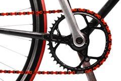 Röd cykelkedja royaltyfria bilder
