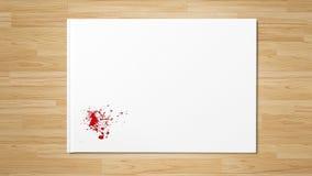Röd droppe plaskar fläckkonstmålarfärg på vitbok royaltyfria bilder