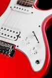Röd elektrisk gitarr på svart bakgrund, closeup Royaltyfria Foton