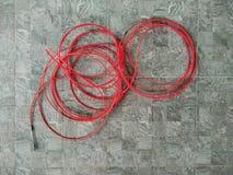Röd elektrisk kabel royaltyfri bild