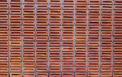 Röd eller orange fyrkantig tegelstenvägg, backgr för textur för kvartertegelstenvägg Royaltyfri Foto