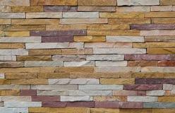 Röd eller orange fyrkantig tegelstenvägg, backgr för textur för kvartertegelstenvägg Arkivbilder