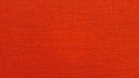 Röd eller orange textur/nära övre röd eller orange tygyttersida Royaltyfri Fotografi
