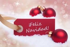 Röd etikett med Feliz Navidad Royaltyfria Bilder