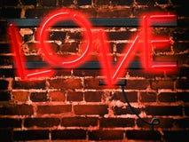 Röd förälskelse för neontecken Fotografering för Bildbyråer