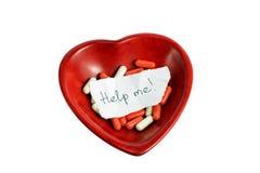 röd förfrågan för hjälphjärta arkivfoton