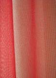 Röd förtjäna gardin Royaltyfri Bild