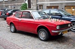 Röd Fiat 128 för tappning sport Arkivfoto