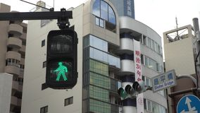 röd fot- för teckenTokyo för övergångsställe 4K ändring för trafik stad till grön färg arkivfilmer