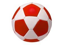 Röd fotboll med den traditionella modellen Arkivfoton