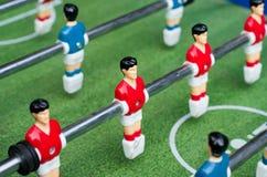 röd fotbolltabell för spelare Royaltyfria Foton
