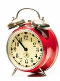 Röd gammal klocka Arkivbild