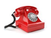 Röd gammalmodig telefon som isoleras på vit Royaltyfri Fotografi