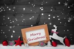 Röd garnering, glad jul, snö, Gray Background, stjärnor Fotografering för Bildbyråer