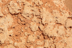 Röd gjuten lera för textur, bakgrund Kanjon Bayanzag fotografering för bildbyråer