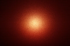 Röd glödande bakgrund med lampa i mitten Royaltyfria Bilder