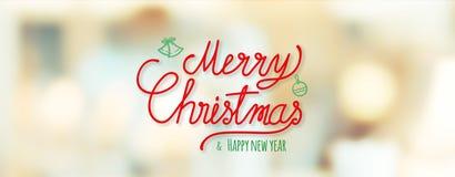 Röd glad jul och handskrift för lyckligt nytt år på suddighetsbokeh royaltyfria foton