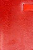 Röd glansig textur för Fauxläderbakgrund royaltyfria foton