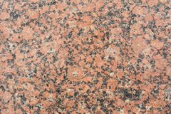 Röd granit för textur med svartsmulor, abstrakt bakgrund fotografering för bildbyråer