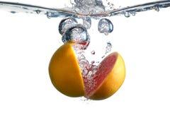Röd grapefrukt och bubbla Fotografering för Bildbyråer