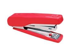 Röd häftapparat som isoleras på vit Fotografering för Bildbyråer