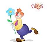 Röd haired clown med blomman Royaltyfria Bilder