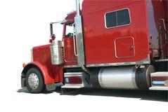 Röd halv lastbil som isoleras Arkivfoto