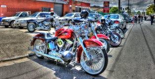 Röd Harley Davidson motorcykel Royaltyfri Bild
