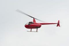 Röd helikopter Arkivfoto