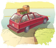 Röd herrgårdsvagn med en last Royaltyfri Fotografi