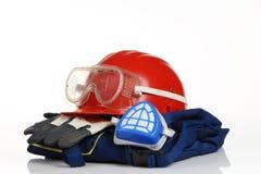 Röd hjälmsäkerhetsutrustning royaltyfri bild