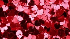 Röd hjärta formade konfettier lager videofilmer