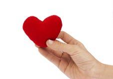 Röd hjärta i kvinna Royaltyfria Bilder
