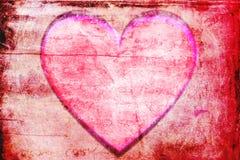 Röd hjärta inramar bakgrund Arkivbild