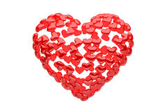 Röd hjärta komponerade av manny små hjärtor - tolkningen 3d - Arkivfoton