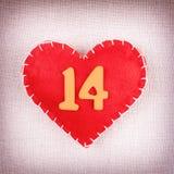 Röd hjärta med trä numrerar 14 Arkivfoto