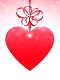 Röd hjärta och pilbåge Arkivfoto